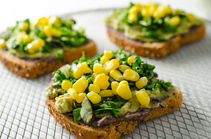 "Nacho Avocado Toast - a delicious vegan, gluten free, ""cheesy"" recipe that's quick and easy!  VeggiePrimer.com"