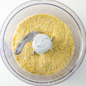 Vegan Parmesan Hummus - a quick and easy recipe with a garlicky cheesy flavor that's hard to resist! | VeggiePrimer.com