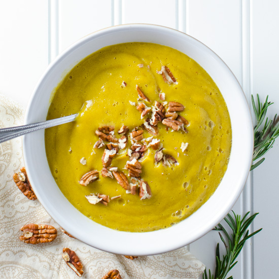 Acorn Squash Soup with Rosemary and Pecans - a slow cooker and high-speed blender make this vegan and gluten free acorn squash soup a cinch to prepare - the sweet and savory recipe yields about 4 cups   VeggiePrimer.com