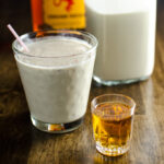 Vegan Eggnog with Cinnamon Whiskey - a creamy sweet and spicy plant-based recipe that's just as tasty as the real thing! | VeggiePrimer.com