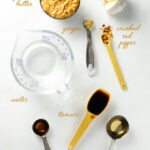 Easy Peanut Sauce - Whip up this simple blender recipe in minutes - this vegan and gluten-free sauce goes great with sushi, salad and spring rolls!   VeggiePrimer.com