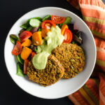 Spicy Lentil Quinoa Burgers with avocado dressing - these gluten-free vegan veggie burgers offer a flavorful blend of protein-rich plant-based ingredients with a little kick. | VeggiePrimer.com