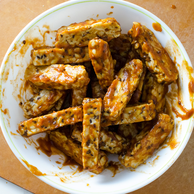 Baked BBQ Tempeh - this quick and easy recipe makes a delicious meat substitute in a variety of gluten-free vegan dishes | VeggiePrimer.com