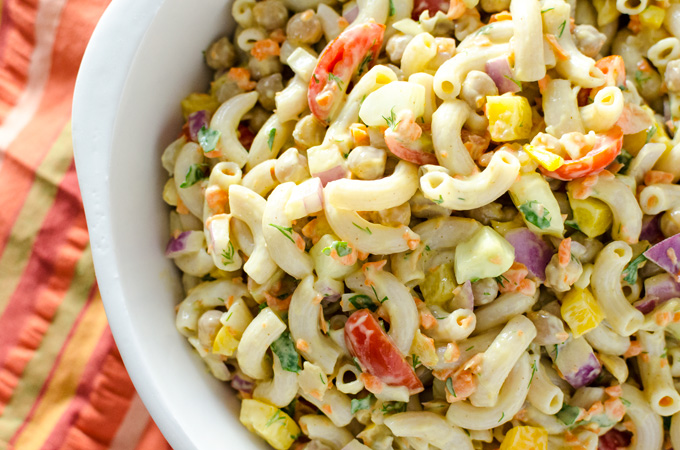 Veggie Pasta Salad with Avocado Mustard Dressing - this gluten-free vegan recipe offers a pleasing combination of pasta, fresh crunchy vegetables and creamy avocado dressing - chickpeas add protein so it works well as a meal or a side dish | VeggiePrimer.com