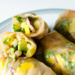 White Bean Mango Spring Rolls - the ingredients in this gluten-free vegan recipe also make a great salad or sandwich wrap! | VeggiePrimer.com