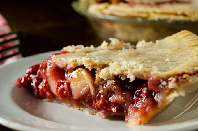 side view of one slice of gluten-free vegan cherry apple pie