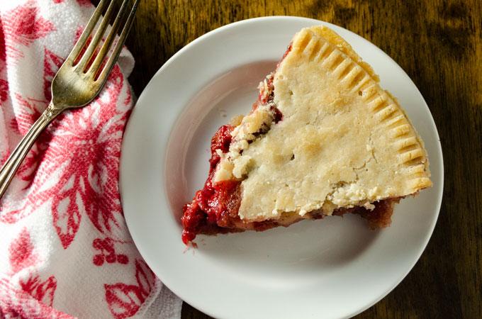top view of one slice of gluten-free vegan cherry apple pie