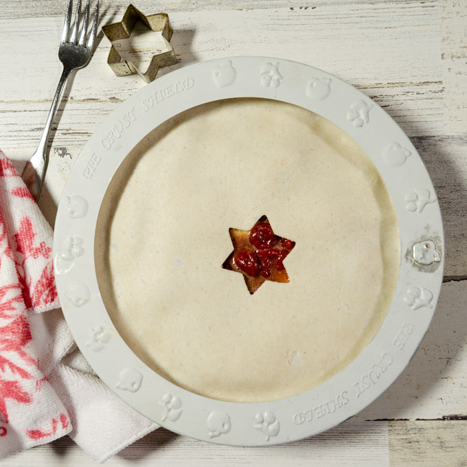 Use a pie shield to prevent gluten-free pie crust edges from browning too quickly