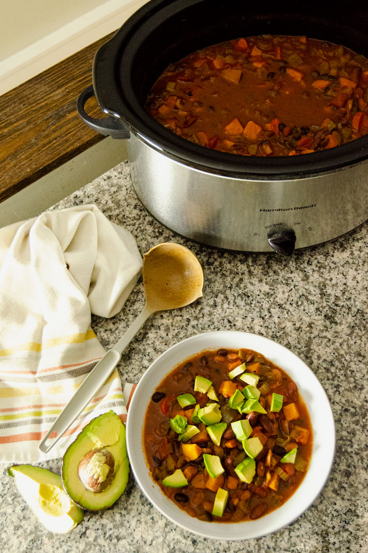 Bowl of Slow Cooker 3 Bean Chili topped with diced avocado